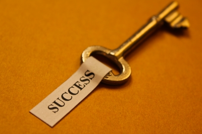 "pic of a key with a ""success"" label on it"