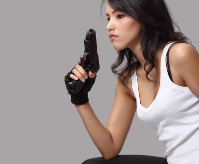 woman holding a gun contemplating suicide