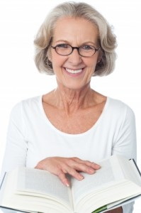 Smiling Senior Woman Reading A Book