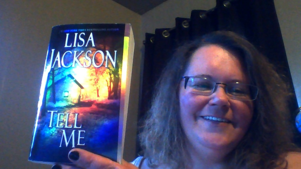 me holding a book I got from author Lisa Jackson