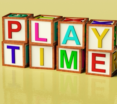 """This picture is one of block letters that spell out """"play time"""" using childrens' building blocks."""