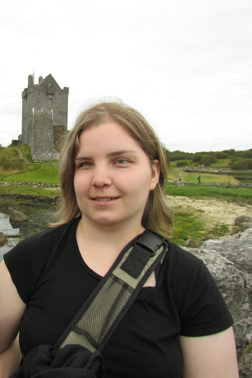 This is a photo of Kerry Kijewski, by a castle, on one of her trips.