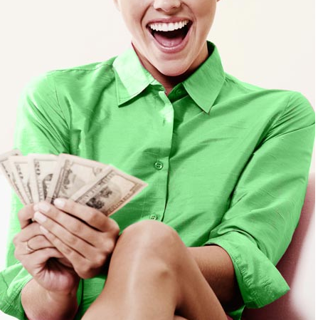 This is an image of a woman holding money she earned from a freelancing job.