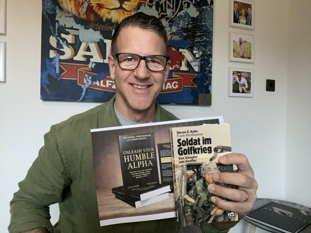 Steven Kuhn holding his book