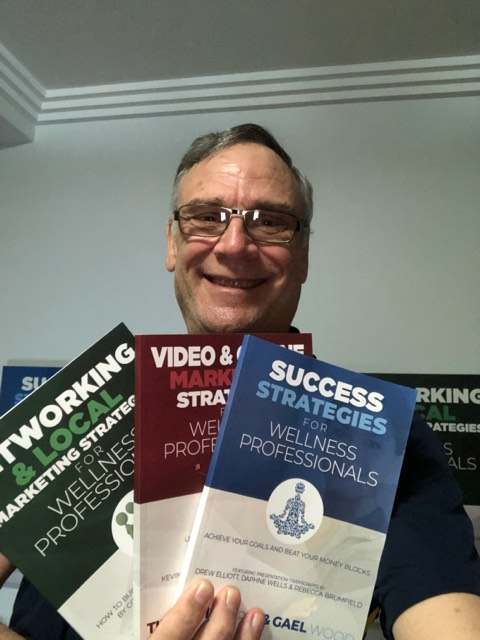 Tim Cooper holding his books
